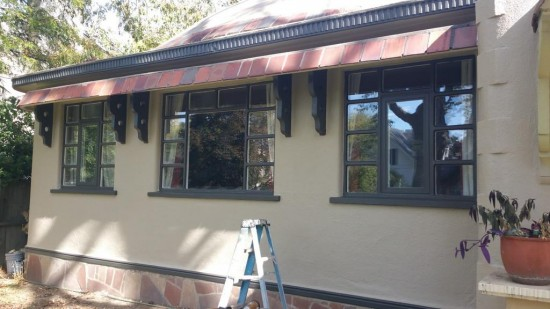gutter repair and replacement services after front stucco