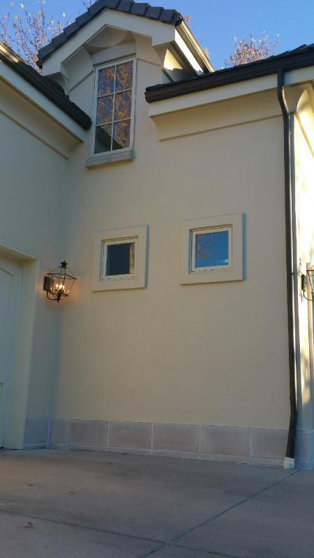 professional commercial painters stucco wall after