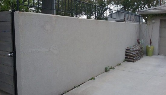 residential painting company stucco wall before